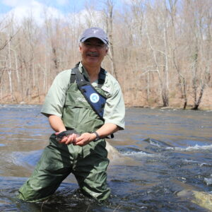 Augusto Russell catches trout while fly fishing