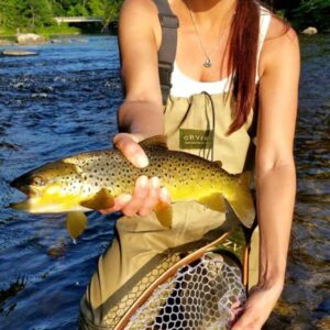 Angela Ziogas, Cross Current Insurance Advisor catches Brown Trout in Farmington River