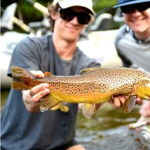 Outdoor enthusiasts brown fish catch